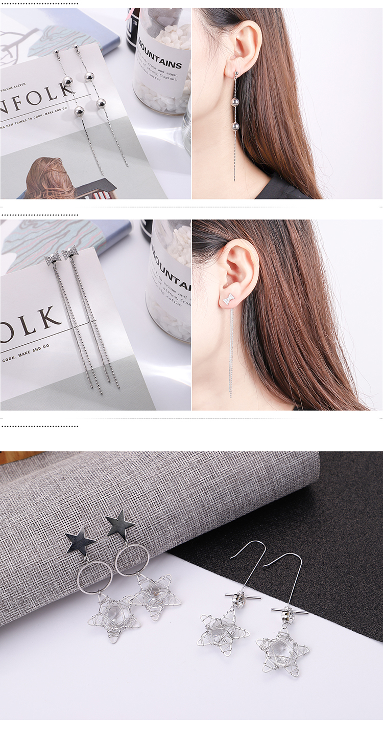 Korean version of the bow personality tassel super fairy earrings NHNPS5527
