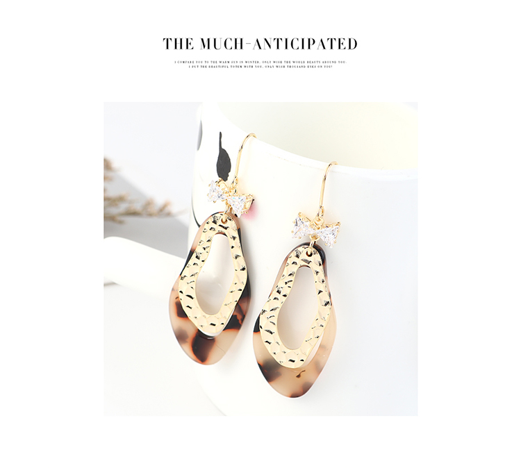 Korean creative trendy wild gold plated leopard bow earrings NHPS203172