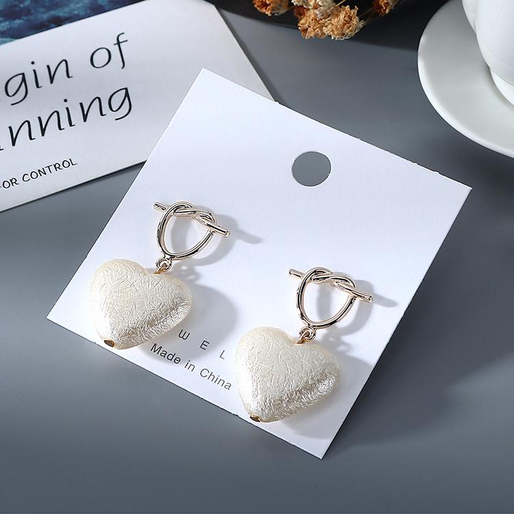 Korean creative fashion retro hollow love pearl earrings for women wholesale NHPS205300